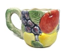 """Fitz and Floyd Ironstone Mug Cup Fruit Pattern Leaves Handle 12 Oz Measurement: 5 1/2"""" width handle to rim X 3 3/4"""" rim to rim X 3 1/2"""" tall Condition: Pr-owned, in good condition. Fruit Pattern, Mug Cup, Soup Bowl Set, Unique Gifts For Men, Handle, Leaves, Vegetable Bowl, Mugs, Serving Platters"""
