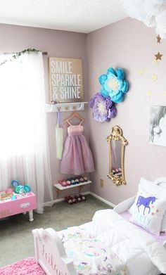 Featuring a unicorn pillow and a dress-up area with a gold mirror, this bedroom is truly every little princess's dream.
