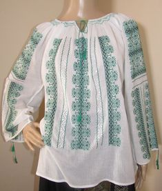 Beautifully hand embroidered Romanian traditional blouse. The embroideries are hand made from white silk thread, green and black cotton thread and every pattern is unique and gorgeous in its design. The finest and sheer gauze cotton. Silk Thread, Cotton Thread, White Silk, Black Cotton, Peasant Blouse, Hand Stitching, Ethnic, Tunic Tops, Pure Products