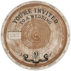 """Wedding wheel    Lauren Fleischer married Andrew Venell in San Francisco, California. Their invitation was a wheel which showed different pieces of wedding information as it was turned. """"Our invitations were designed to capture both the grand, natural elements of Northern California - we had the ceremony within a gorgeous ring of redwoods,"""" explains Lauren."""