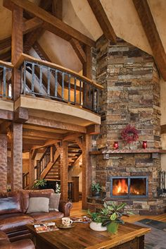 Love the railing! An inviting view of a Custom Timber Frame Home. This PrecisionCraft creation has a tall stone fireplace perfect for those cold winter nights. A Timber Frame Home can offer a more modern feel to the rustic old tradition of Log Homes. Timber Frame Homes, Timber House, Timber Frames, Log Home Decorating, Decorating Ideas, Rustic Home Design, Log Cabin Homes, Log Cabins, Style Deco