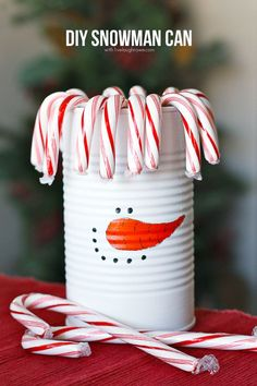DIY Snowman Can using a soup can and acrylic paint to create this adorable snowmans!  Tutorial at livelaughrowe.com