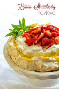 Lemon Pavlova - this beautiful version of the classic dessert crosses the flavours of lemon meringue pie with strawberries and cream. Rock Recipes, Gourmet Recipes, Sweet Recipes, Dessert Recipes, Gourmet Foods, Delicious Recipes, Pavlova Cake, Meringue Pavlova, Meringue Pie