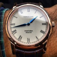 White face, brown leather, gold rim, blue hands.. Gorgeous