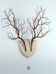 If you enjoy the aesthetic appeal of animal antlers but hate the idea of taxidermy, Elkebana might be just the thing for your cabin walls. The wall-mounted system relies on symmetrical sets of flowers or tree branches and gets its name from ikebana, the Japanese art of flower arrangement.