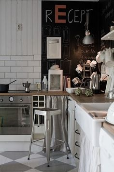 French industrial kitchen - subway tiles, chalk wall is a must
