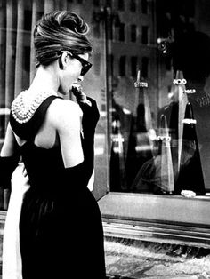 Audrey aka Holly Golightly eating breakfast at Tiffany's as I did in 1964 (except for the formal attire)