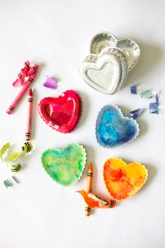 Kid-friendly Valentine's Day craft project. Let the kids help sort by color, peel and break crayons into small pieces. Place the crayons in heart-shaped molds and bake in a 250 degree oven for about 15 minutes. Let cool. Pop the finished hearts out of the molds and package in cellophane bags stuffed with the crayon paper peelings. Add a tag that says: Valentine, you melt my heart. Lots of other mold shapes can be used for different holiday gifts.