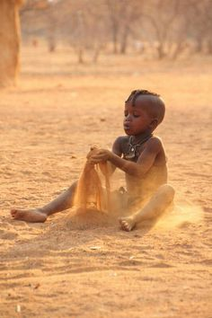 Sand castles . Himba child . Namibia