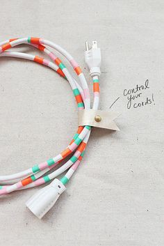 Using Washi tape to make charger cords cuter. 41 Amazing Free People-Inspired DIYs