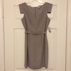 Forever 21 - Grey Dress with Belt NWT - Forever 21 Grey Dress with an abstract shoulder detail and matching belt. Brand new, still has tags. I'm always open to offers & can be bundled with another item in my closet for a special bundle discount. ❤️ NO TRADES / NO PAYPAL ❤️ Forever 21 Dresses
