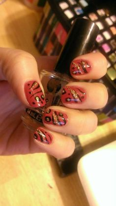 Mixed animal print in pink, black, and gold