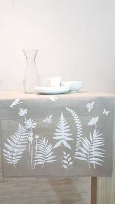 Tablecloth, table runner hand print with white floral, leaves sewn from natural linen fabric. Shibori Fabric, Linen Fabric, Creative Textiles, Fabric Stamping, Tablecloth Fabric, Linen Napkins, Hand Embroidery Patterns, Printing On Fabric, Hand Printed Fabric