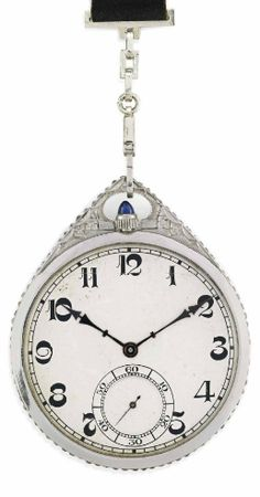 AN ART DECO SAPPHIRE, DIAMOND AND PLATINUM POCKET WATCH, BY ZENITH WITH A VELVET, ONYX AND GOLD RIBBON