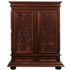 French Early 17th Century Louis XIII Period Walnut Armoire with Geometric Motifs | From a unique collection of antique and modern wardrobes and armoires at https://www.1stdibs.com/furniture/storage-case-pieces/wardrobes-armoires/