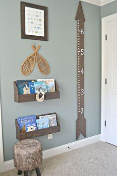 Trust us: Your baby will grow quicker than a weed. Install a chart in their room to track his or her height, like this adorable, rustic arrow for a little boy's room. See more at Fawn Over Baby.