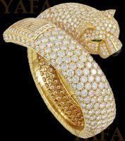 CARTIER Diamond, Onyx and Emerald Eyes Panther Watch Bracelet