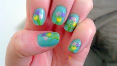 Mother's Day Bouquet of Tulips Nail Art check out www.ThePolishObsessed.com for more nail art ideas.
