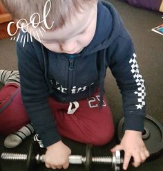 My youngest son pumping iron!  #pumpingiron #buildingmuscle #dadlife #childhoodunplugged