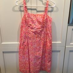 Lilly Pulitzer Sundress The perfect sun dress, casual, adjustable straps, knee length, pockets and still has the dry cleaning tag on it. Worn one or two times and in perfect condition Lilly Pulitzer Dresses