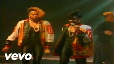 Salt-N-Pepa - Push It (1986) The all-female hip hop group Salt N Pepa were style icons in hip hop fashion during the 80s; popularizing the asymmetrical hair cut (with one side of head shaved), oversized jackets paired with tight leggings or unitard, and chucky gold chains for women.  Source: https://www.youtube.com/attribution_link?a=VSXpms5h86M&u=/watch%3Fv%3DvCadcBR95oU%26feature%3Dshare