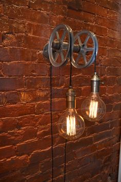 DESCRIPTION: This light is based on our single wall Pulley concept but uses two steel pulley wheels.. From the wall to the end of the pulley is