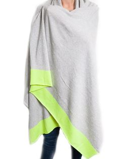Neon Cashmere Travel Wrap. A supercosy, stylish travel wrap in classic grey with modern neon flashes of colour. Ideal for trips away, winter walks or even cosying up in front of the fire. and an ideal luxury gift for someone special or a very justifiable gift to self. £185 #cashmere #neon #wrap #gifts #ideas