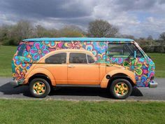 I thought I saw 2 cars at first.... Now that's groovy....Go Flower Power!!! LOL.