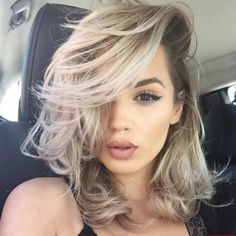 MESSY LONG BOB WITH BANGS This cut and hair color makes for a perfect laid-back summer style. The hairstyle proves that bobs aren't just for women with straight hair. Soft layers, curls, and ash blonde hair color will make your facial features pop.