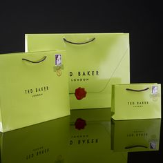 Ted Baker Artpaper Carrier bags. Printed inside and out with Ted bakers original design, finished with a gloss lamination and matching handles #packaging