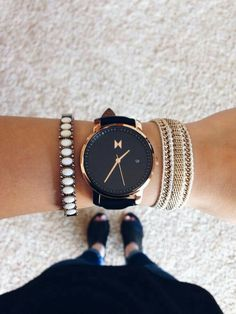 Black and gold leather Movement watch.