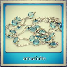 Beautiful blue topaz set in 14k gold. By-the-yard/vintage design. Hand made in New York City.  http://stores.ebay.com/amazinite