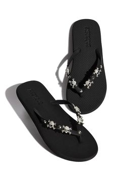Add an edgy touch to your look: with the skull sandals by Mystique.