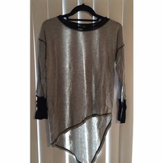 LF TOP LF stylish top looks perfect paired with leather pants/leggings! Mesh neck lining and black and white striped sleeves make this casual grey top both stylish and fashion forward. Size Large ( Fits 3-6) LF Tops Tees - Long Sleeve