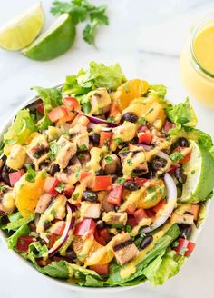 Grilled Caribbean Chicken Salad with 5 Minute Mango Dressing – Packed with juicy chicken, sweet oranges, black beans, and crunchy veggies, this is WAY better than any restaurant salad for a fraction of the cost! @wellplated