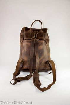 Waxed brown leather one pocket backpack in large size made from 100% genuine leather decorated with an evil eye key ring. In Christina Christi Jewels store you can see more than 30 designs in Leather Backpacks You can have them in 2-4 Days with DHL EXPRESS SHIPPING YOU CAN BUY