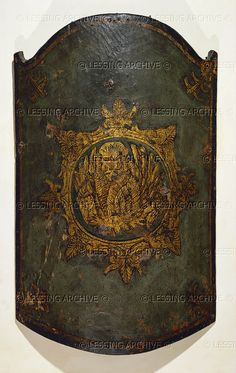 Venetian target (full-length shield) leather and gold paint, showing the Venetian Lion of Saint Mark.   Palazzo Ducale, Mantova, Italy
