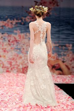 Claire Pettibone Devotion Wedding Dress. The Devotion dress is a beautiful light feeling dress. It is so comfortable and so beautiful and flowy. I wore this for my intimate wedding on the beach in Sai