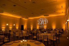 How amazing and romantic does this amber uplighting look? #lighting #wedding #reception