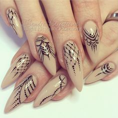 nude stiletto nail with detailed goth/lace design