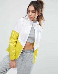 Nike - Veste coupe-vent à capuche - Blanc et jaune