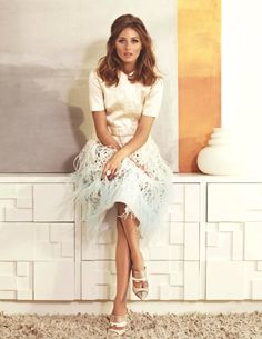 Love the silhouette -- frothy skirt, boxy top, architectural tootsies.  Oh, and it doesn't hurt to be as beautiful as Olivia P.
