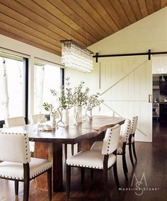 A sliding barn door is a unique way to separate the dining and kitchen areas