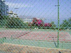 Play tennis, and enjoy the beautiful view. www.spanish-school-herradura.com