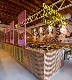 Modern Asian Restaurant Chi Chi in Sydney, designed by Matt Woods, Featured on Design Sponge, Warehouse, neon yellow black pink and natural wood accents, manga style mural