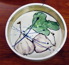Round Baker with Figs by Donna Toohey. American Made. See the designer's work at the 2015 American Made Show, Washington DC. January 16-19, 2015. americanmadeshow.com #baker, #ceramic, #figs, #americanmade