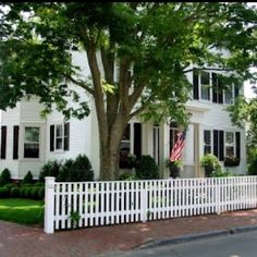 Dream Home! Cape Cod style with a bright red door and black shutters Annnnnnd of course a white picket fence ;)