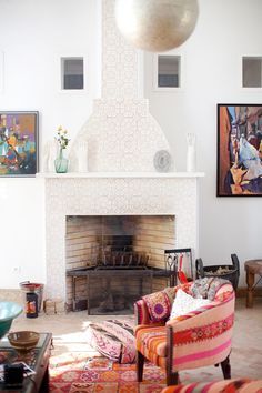 Lots of white but Moroccan - love the lace look on the fireplace. Could be a compromise for Tim's and my own style?