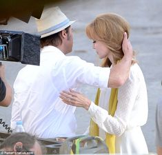 Hold me tender:The handsome 50-year-old pulled Angelina into his chest for an embrace as a camera operator captured each and every tender moment