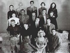 Twentieth Century Studio - Front Row: Darryl F. Zanuck, ?, Victor Mature - 2nd Row: Jeff Chandler, Marjorie Main, Rock Hudson, James Stewart - 3rd Row: Maureen O'Hara, Stephen McNally, Julie Adams, Ronald Reagan, Barbara Stanwyck - 4th Row: Ann Blyth, Virginia Field, Tony Curtis, ?, Loretta Young